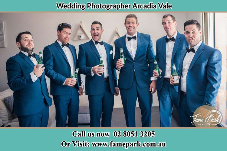 The groom and his groomsmen striking a wacky pose in front of the camera Arcadia Vale NSW 2283