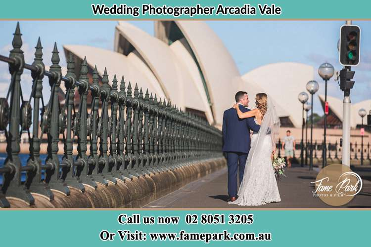 The Groom and the Bride walking towards the Sydney Grand Opera House Arcadia Vale