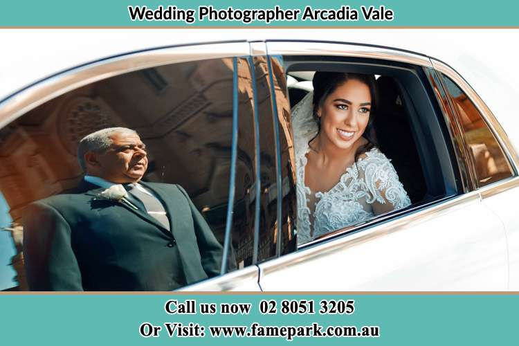 Photo of the Bride inside the bridal car with her father standing outside Arcadia Vale NSW 2283