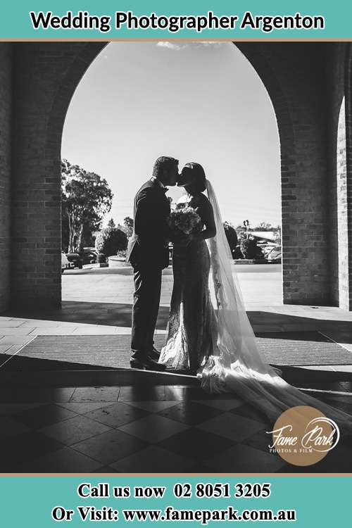 Photo of the Groom and the Bride kissing Argenton NSW 2284