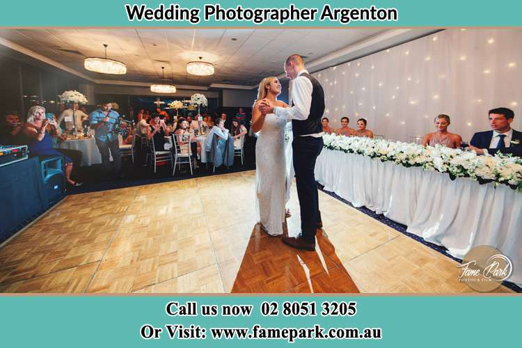 Photo of the Bride and Groom dancing Argenton