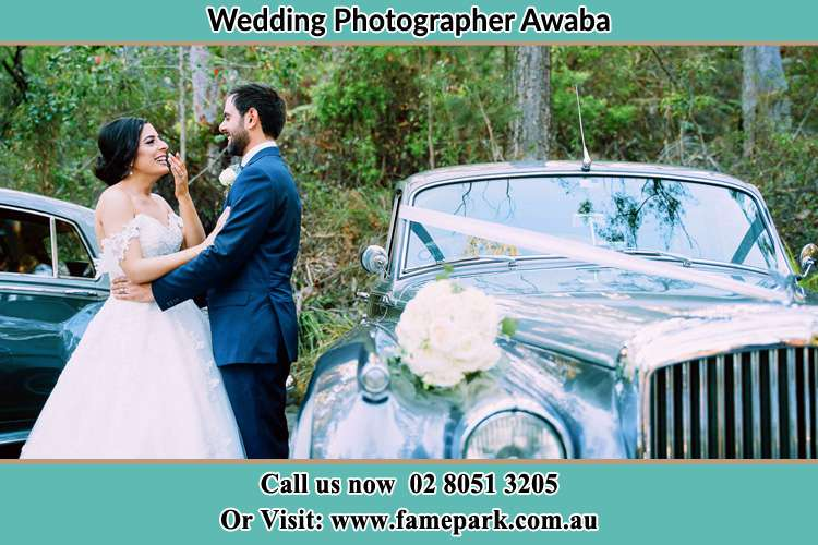 Photo of the Bride and the Groom near the bridal car Awaba NSW 2283