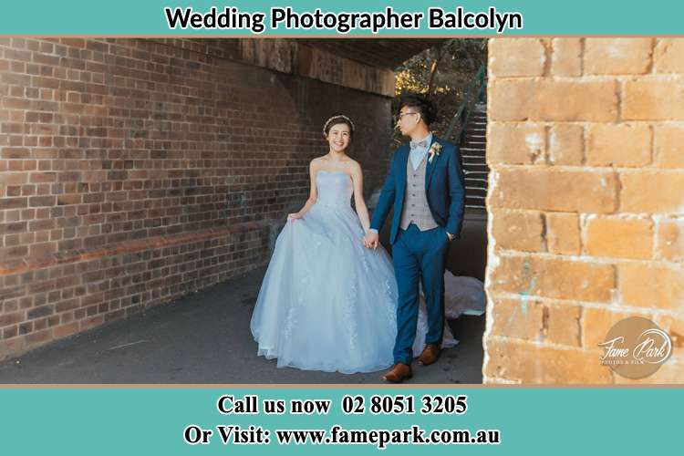 Photo of the Bride and the Groom walking Balcolyn NSW 2264