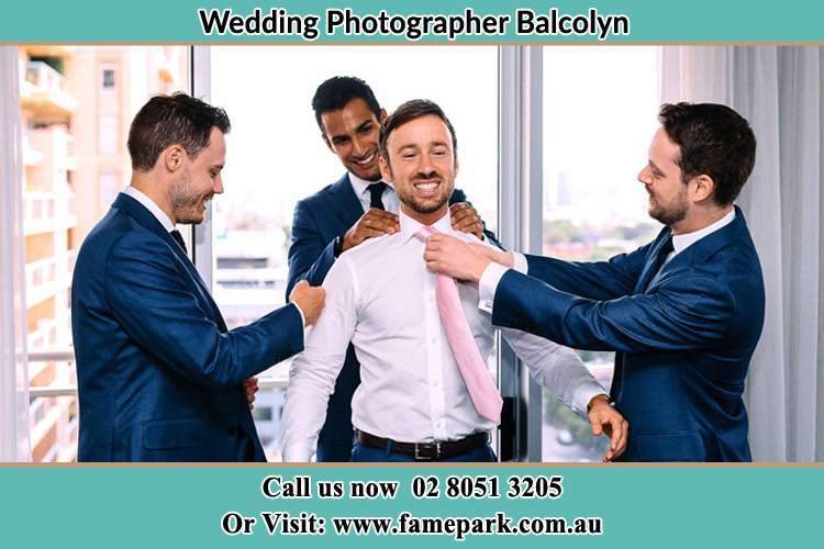 Photo of the Groom helping by the groomsmen getting ready Balcolyn NSW 2264