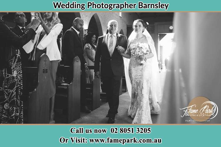 Photo of the Bride with her father walking down the aisle Barnsley