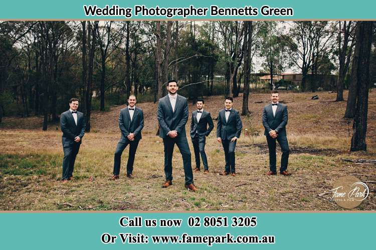 The Groom with his groomsmen pose in front of the camera Bennetts Green