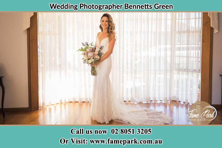 Photo of the Bride holding flower bouquet Bennetts Green NSW 2290