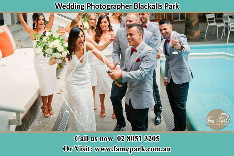 Photo of the Groom and the Bride celebrating with the secondary sponsors Blackalls Park NSW 2283
