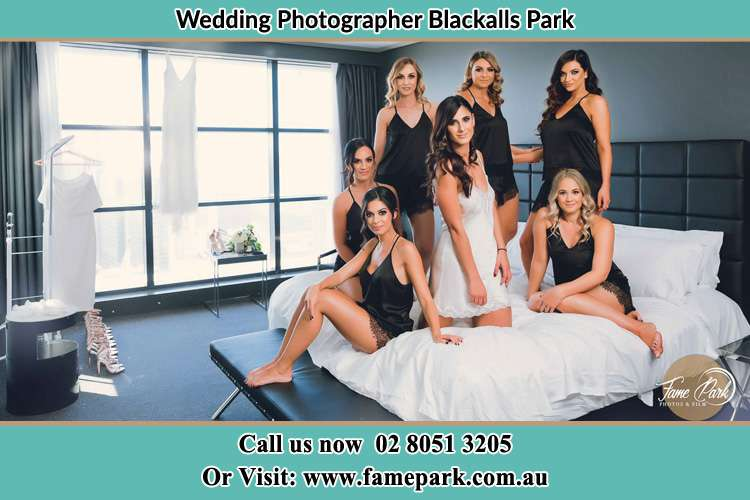 Photo of the Bride and the bridesmaids wearing lingerie on bed Blackalls Park NSW 2283