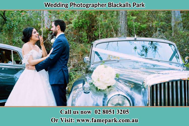 Photo of the Bride and Groom beside the bridal car Blackalls Park