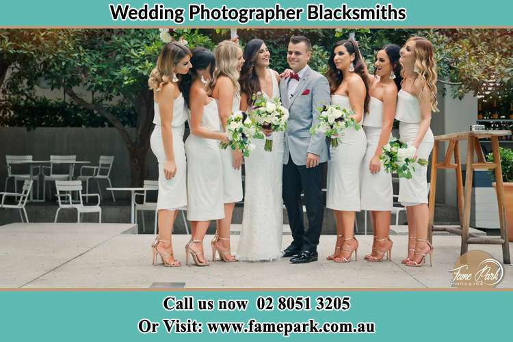 Photo of the Bride and the Groom with the bridesmaids Blacksmiths NSW 2281