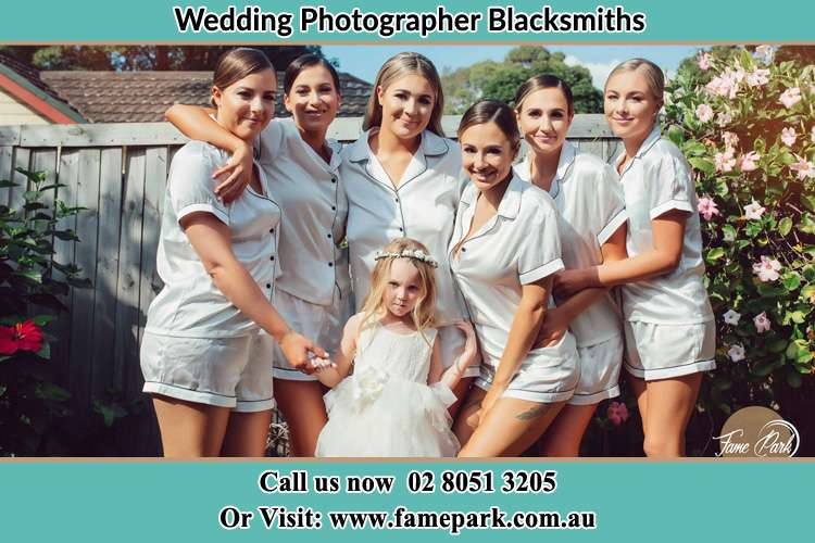 Photo of the Bride and the bridesmaids with the flower girl Blacksmiths NSW 2281