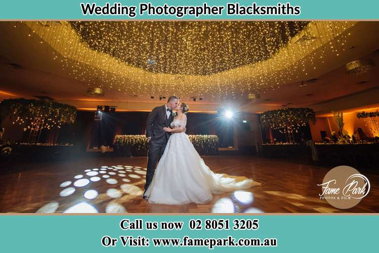 Photo of the Bride and Groom kissing at the dance floor Blacksmiths