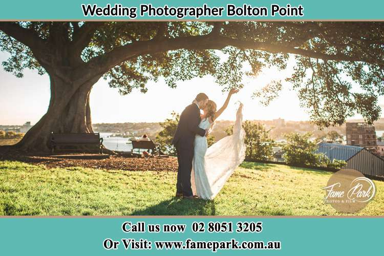 Photo of the Bride and the Groom kissing under the tree Bolton Point NSW 2283