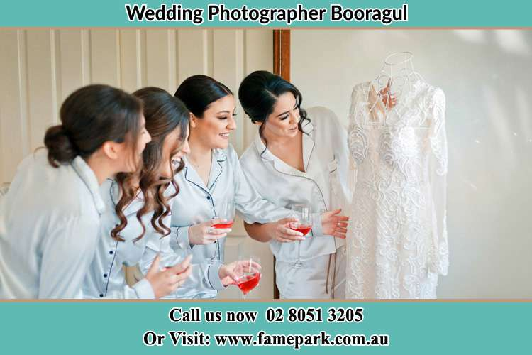 Photo of the Bride and the bridesmaids checking the wedding gown Booragul NSW 2284