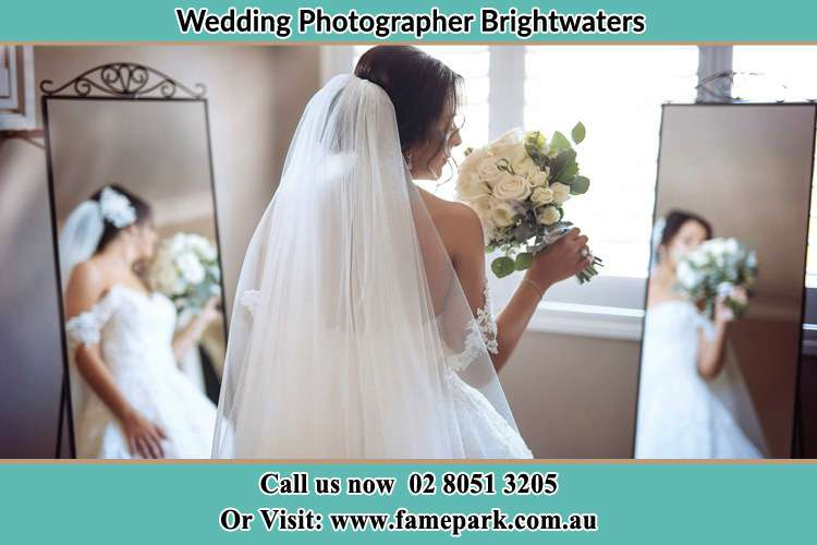 Photo of the Bride holding flower at the front of the mirrors Brightwaters NSW 2264