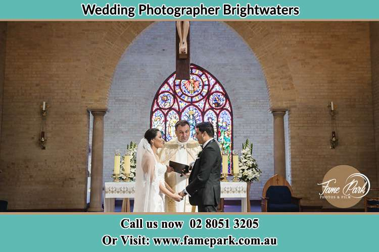 Photo of the Bride and Groom at the Altar with the Priest Brightwaters NSW 2264