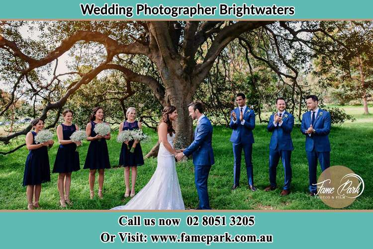 Photo of bride and groom with their entourage Brightwaters