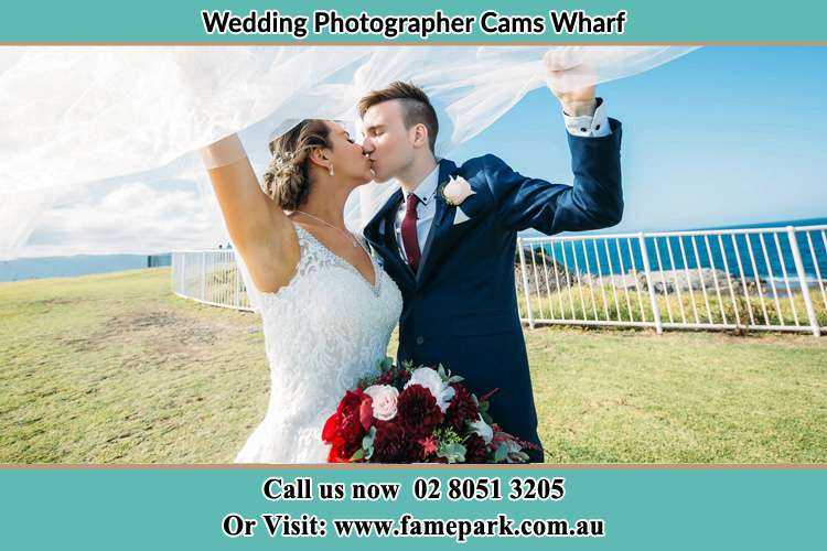 Photo of the Bride and the Groom kissing at the yard Cams Wharf NSW 2281