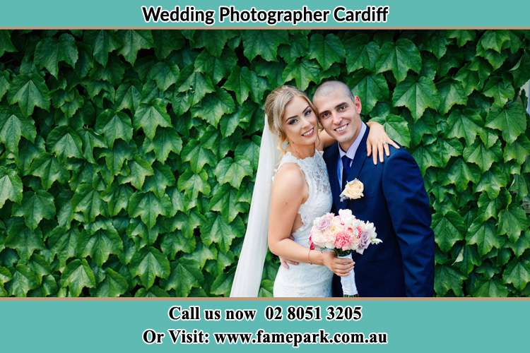 The Bride and the Groom happily pose for the camera Cardiff
