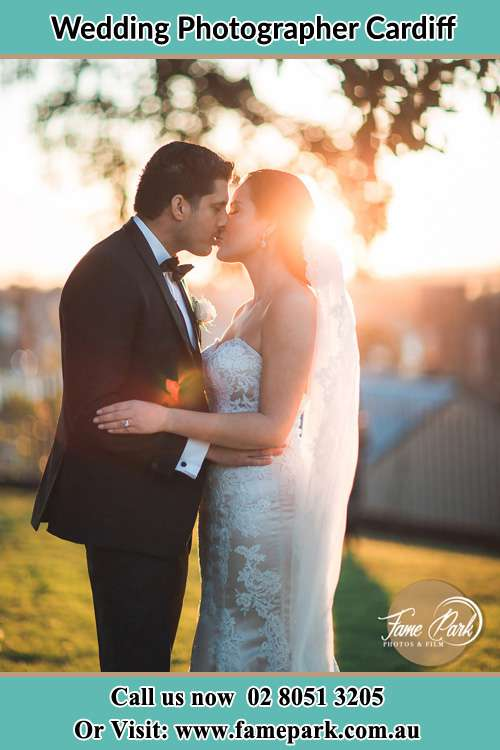 Photo of the Groom and the Bride kissing at the yard Cardiff NSW 2285