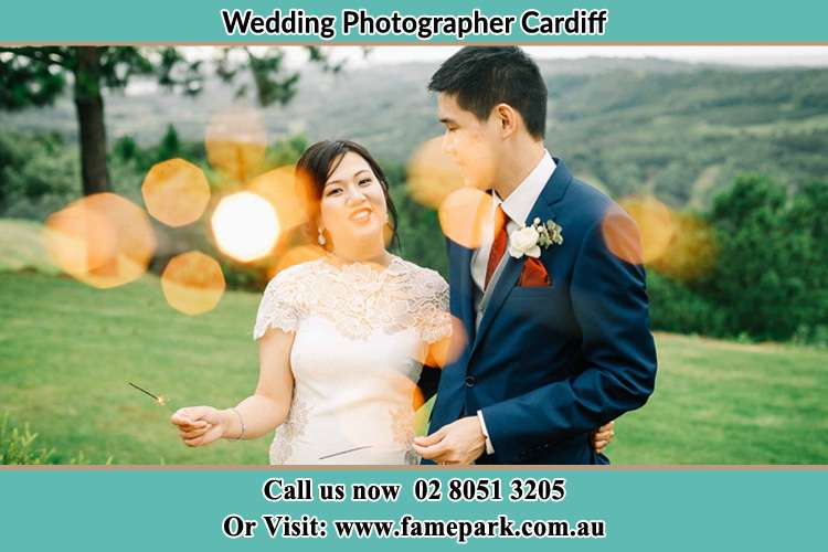 Photo of the Groom and the Bride having a nice chat at the yard Cardiff