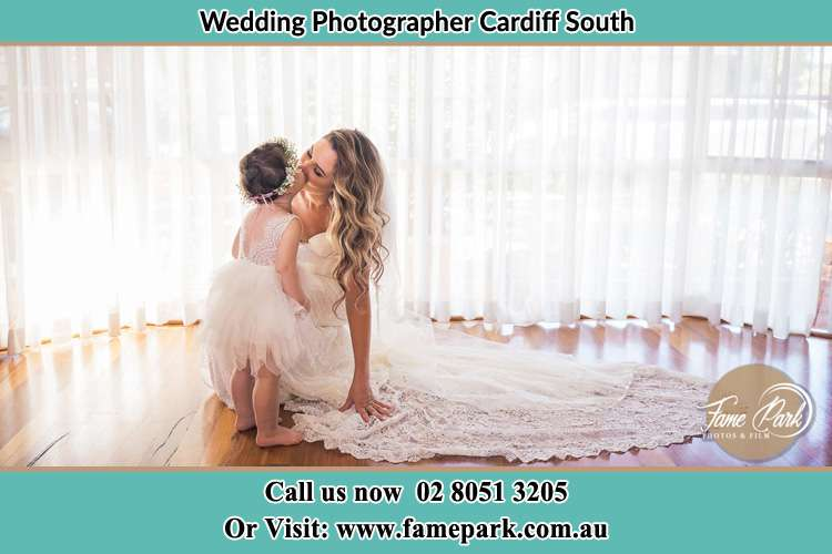 Photo of the Bride kiss the flower girl Cardiff South NSW 2285