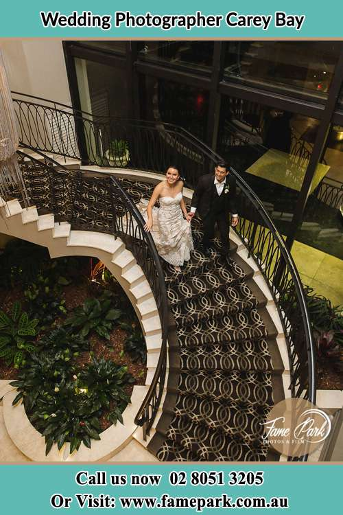 Photo of the Bride and Groom going down the stairs Carey Bay