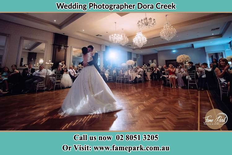 Photo of the Bride and the Groom hugging on the dance floor Croudace Bay NSW 2280
