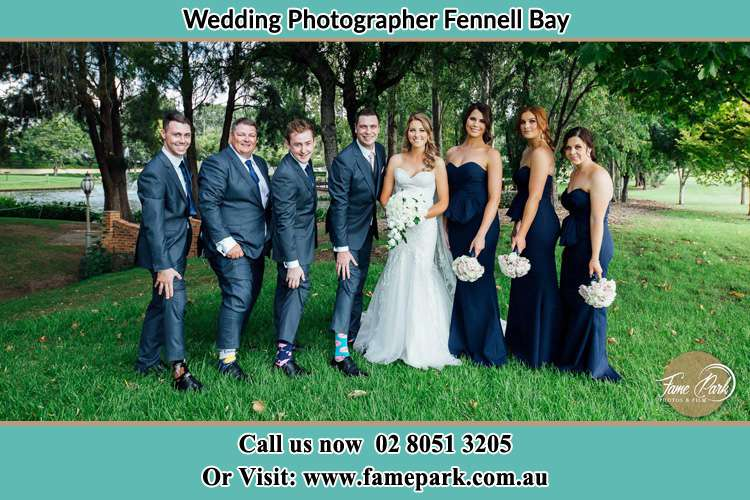 The Bride and the Groom with their entourage pose for the camera Fennell Bay NSW 2283