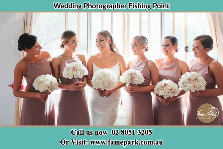 Photo of the Bride and the bridesmaids with flower bouquet Fishing Point NSW 2283