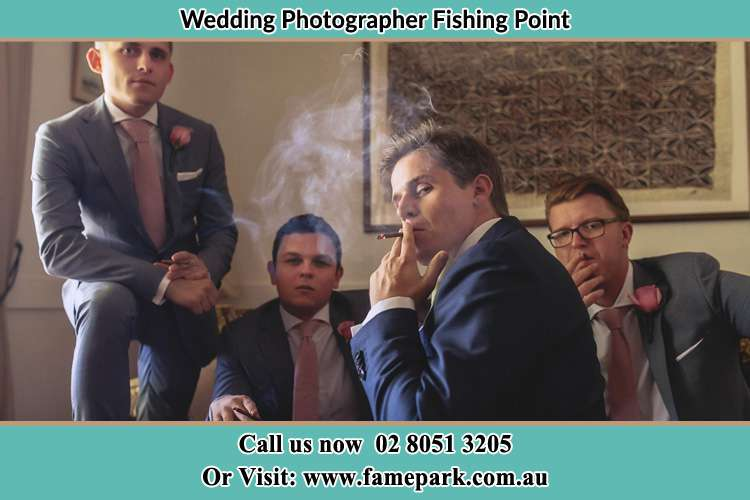 Photo of the Groom relaxing with the boys Fishing Point