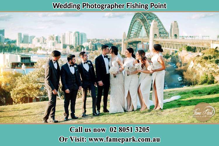 Photo of the Groom and the Bride with the entourage near the bridge Fishing Point NSW 2283
