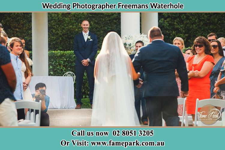 Photo of the Bride with her father walking the aisle Freemans Waterhole NSW 2323