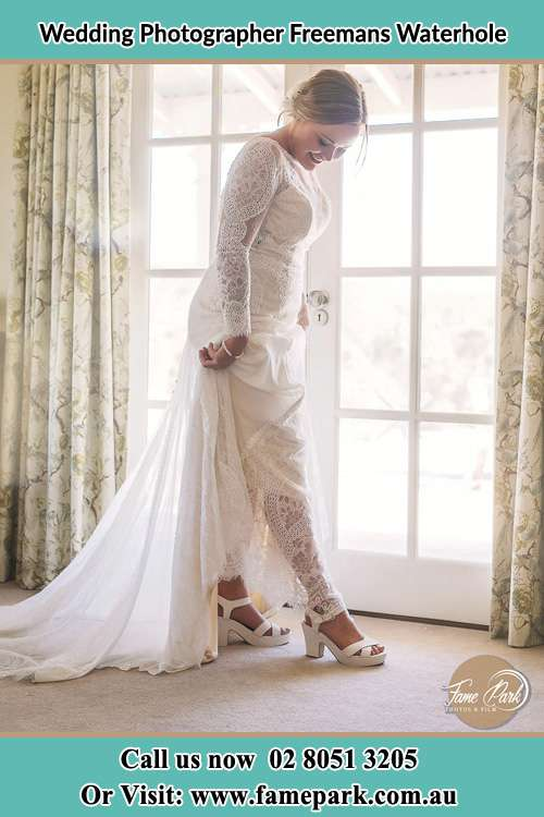 Photo of the Bride looking at her shoes Freemans Waterhole