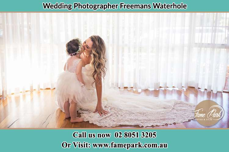 Photo of the Bride kiss the flower girl Freemans Waterhole NSW 2323