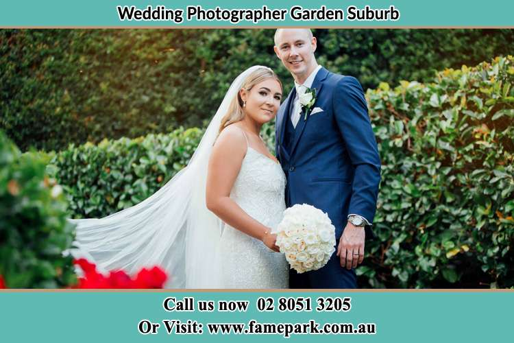 The Groom and the Bride in the garden poses for the camera Garden Suburb