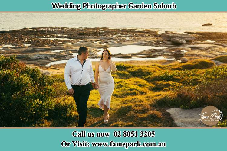 Photo of the Groom and the Bride walking near the lake Garden Suburb NSW 2289