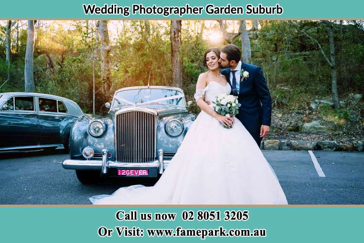 Photo of the Bride and the Groom at the front of the bridal car Garden Suburb NSW 2289