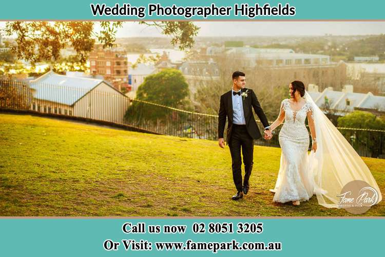 Photo of the Groom and the Bride walking at the yard Highfields NSW 2289