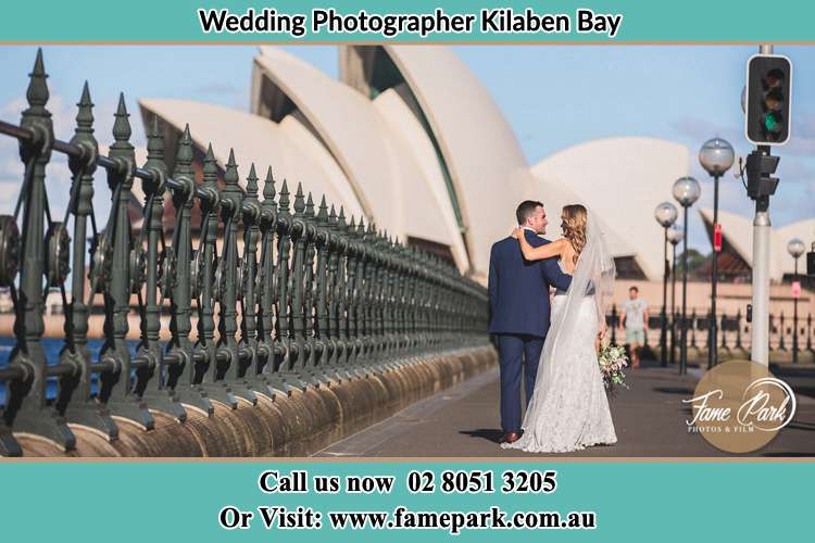 The Groom and the Bride walking towards the Sydney Grand Opera House Kilaben Bay NSW 2283