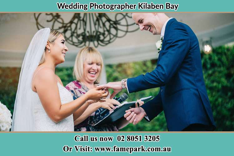 Photo of the Bride wearing ring to the Groom Kilaben Bay NSW 2283