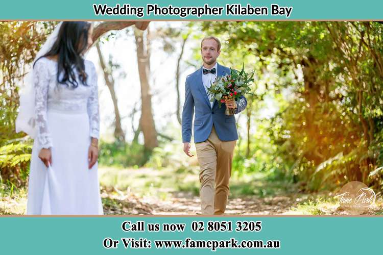 Photo of the Groom bringing flower to the Bride Kilaben Bay NSW 2283