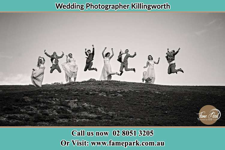 Jump shot photo of the Groom and the Bride with the entourage Killingworth NSW 2278
