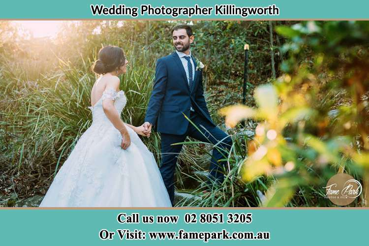 Photo of the Bride and the Groom going up the hill Killingworth NSW 2278