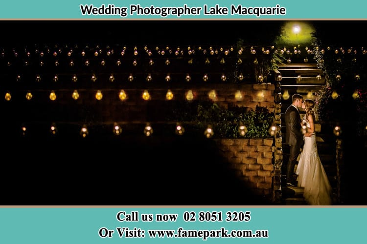 Bride And Groom Kiss In The Garden At Night Lake Macquarie