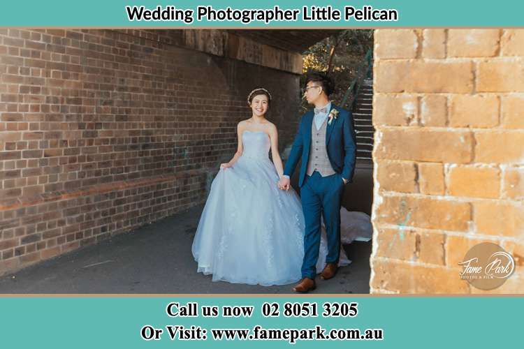 Photo of the Bride and the Groom walking Little Pelican NSW 2281