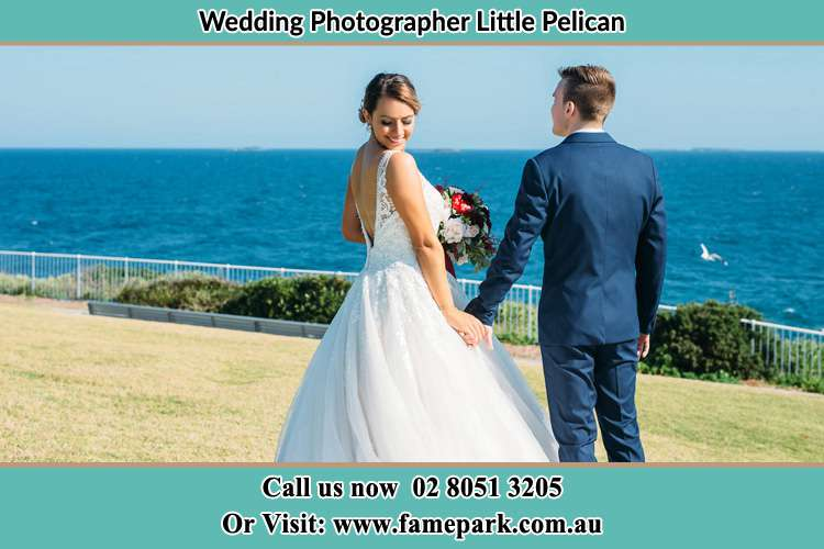 Photo of the Bride and the Groom holding hands at the yard Little Pelican NSW 2281