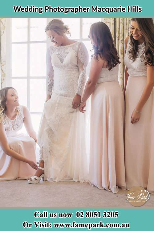 Bride putting her shoes with the help of her Bride's maids Macquarie Hills