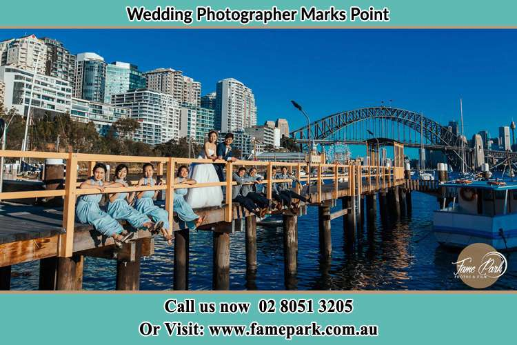 Photo of the Groom and the Bride with the entourage at the bridge Marks Point NSW 2280